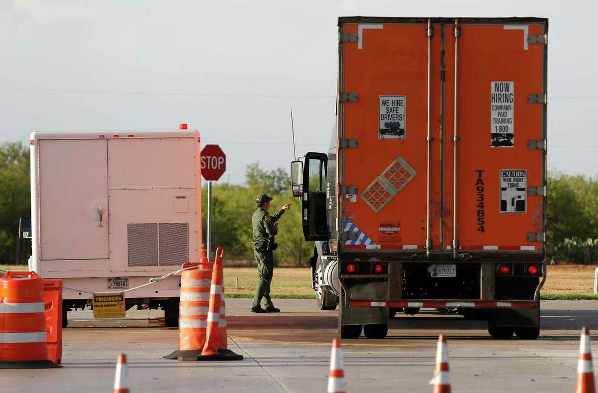 A Customs and Border Patrol agent inspects a commercial truck in the secondary inspection station at the checkpoint 27 miles outside Laredo on Tuesday, July 25, 2017. A number of smugglers hiding undocumented immigrants in their trailers have been caught at the Laredo checkpoints.