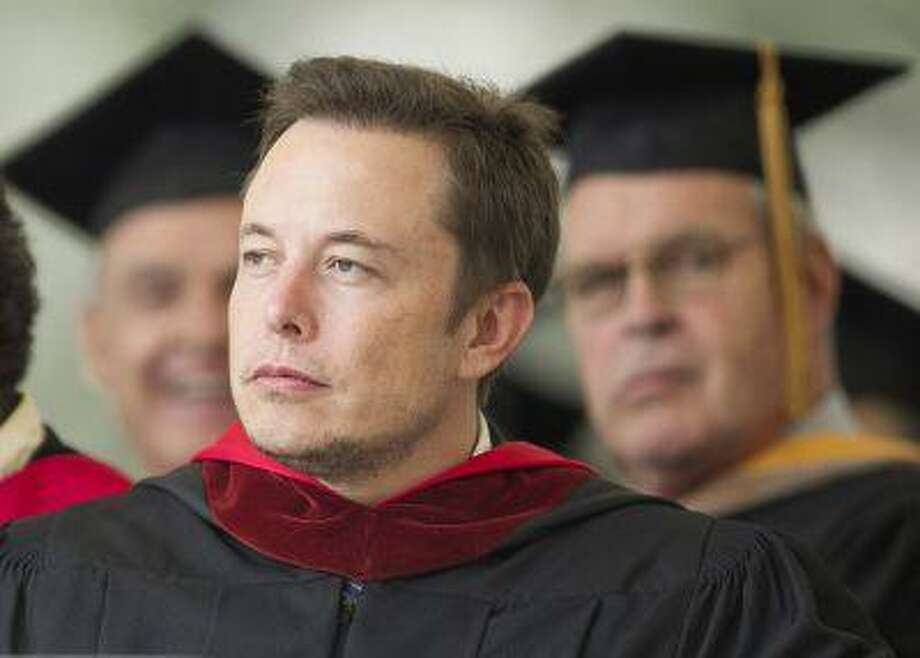 File- This June 15, 2012 file photo shows SpaceX CEO and Chief Designer Elon Musk pausing during his commencement speech for Caltech graduates in Pasadena, Calif. Twice as fast as an airplane, cheaper than a bullet train and completely self-powered: that's the mysterious transportation system that inventor and entrepreneur Musk is promising to reveal design plans for Monday Aug. 12, 2013. (AP Photo/Damian Dovarganes) Photo: AP / AP