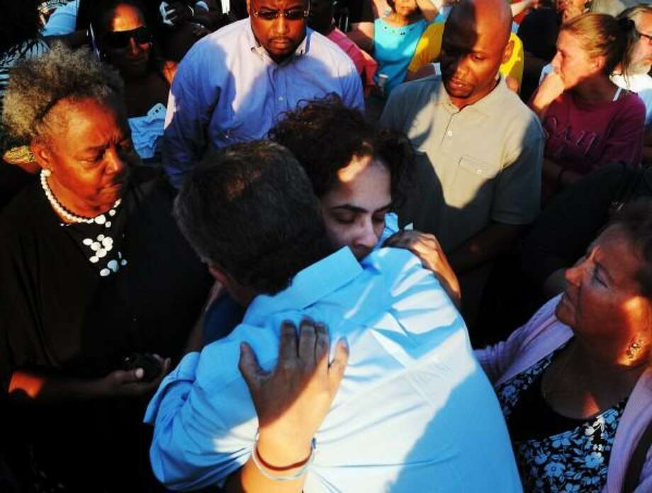 August 10, 2013. East Haven: a vigil was held after the plane crash deaths of four people in East Haven. Two of the victims were East Haven children, whose mother Joann Mitchell, is hugged by East Haven Mayor Joseph Maturo. Mara Lavitt/New Haven Register