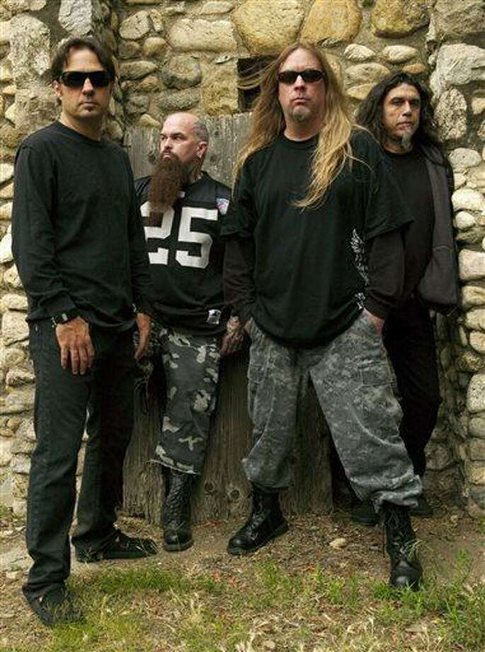 This 2009 publicity photo provided courtesy of Slayer shows, from left, Dave Lombardo, Kerry King, Jeff Hanneman and Tom Araya. Hanneman, 49, a founding member of the heavy metal band Slayer, has died. Slayer spokeswoman Heidi Robinson-Fitzgerald  says Hanneman died Thursday morning, May 2, 2013, of liver failure at a Los Angeles hospital with his wife, Kathy, by his side. (AP Photo/Courtesy of Slayer, Mark Seliger) Photo: AP / Slayer