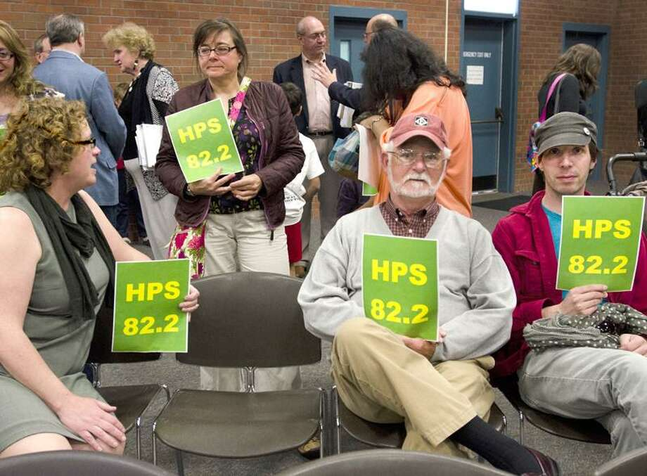 HAMDEN--People from the Spring Glen area wait for the meetiing on school funding to begin at the Miller Library.  Holding signs left to right: Tammy Freeberg, Evelyn Neuber, John Sancomb, and Jeff Mueller.  The 8.2 refers to the Superintendent's requester budget.    Melanie Stengel/Register