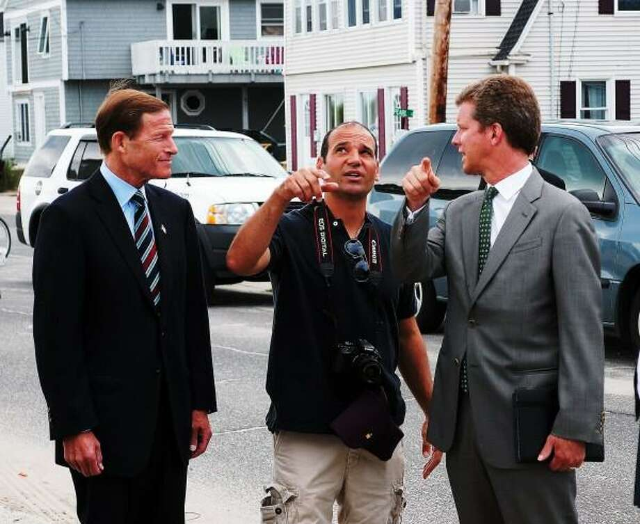"Robert Vercellone, center, talks about the damage to his house during storm Sandy to Senator Richard Blumenthal, left, and Hud Secretary Shaun Donovan as Donovan and Governor Malloy visited the homes on Broadway. Peter Casolino/New Haven Register <a href=""mailto:pcasolino@newhavenregister.com"">pcasolino@newhavenregister.com</a>"
