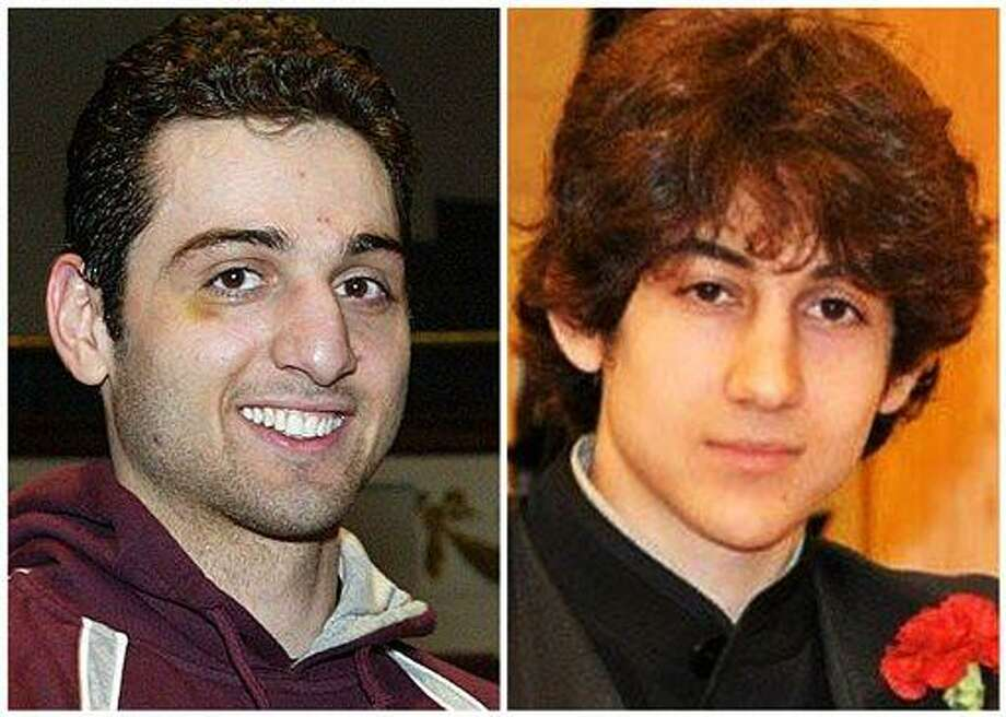 """FILE - This combination of undated file photos shows Tamerlan Tsarnaev, 26, left, and Dzhokhar Tsarnaev, 19. The FBI says the two brothers are the suspects in the Boston Marathon bombing, and are also responsible for killing an MIT police officer, critically injuring a transit officer in a firefight and throwing explosive devices at police during a getaway attempt in a long night of violence that left Tamerlan dead and Dzhokhar captured, late Friday, April 19, 2013. Tamerlan and Dzhokhar Tsarnaev sought to embrace American lives after immigrating from Russia _ joining a boxing club, winning a scholarship and even seeking U.S. citizenship. But their uncle last week angrily called them """"losers"""" who failed to feel settled even after a decade of living in the United States. (AP Photo/The Lowell Sun & Robin Young, File) Photo: AP / AP"""