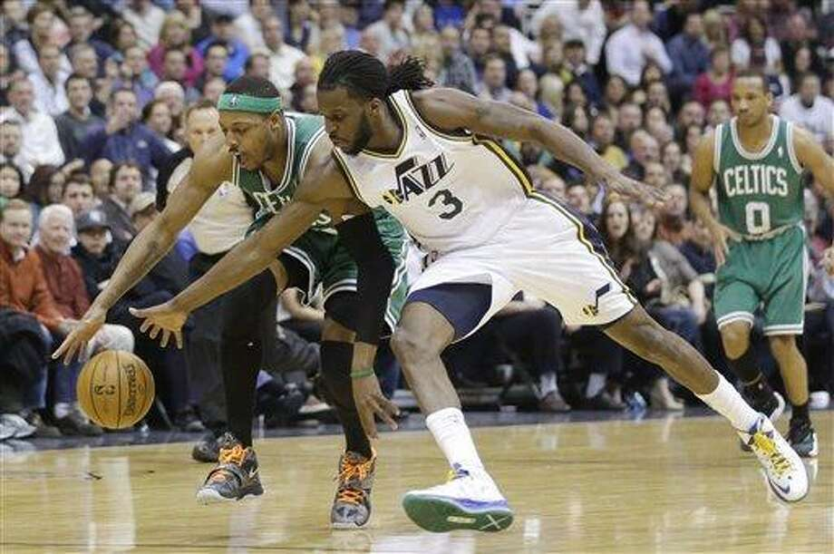Boston Celtics' Paul Pierce, left, and Utah Jazz's DeMarre Carroll (3) chase a loose ball in the second half during an NBA basketball game Monday, Feb. 25, 2013, in Salt Lake City. Celtics defeated the Jazz 110-107. (AP Photo/Rick Bowmer) Photo: ASSOCIATED PRESS / AP2013