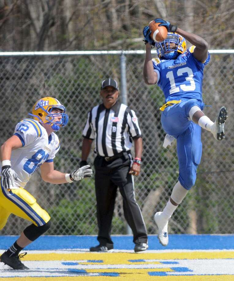 University of New Haven defensive back Herbens Antenor intercepts a pass, right, against Brett Parenteau during the Blue-White Spring football game Saturday, April 27, 2013 at the  university's DellaCamera Stadium  Photo by Peter Hvizdak / New Haven Register Photo: New Haven Register / ©Peter Hvizdak /  New Haven Register
