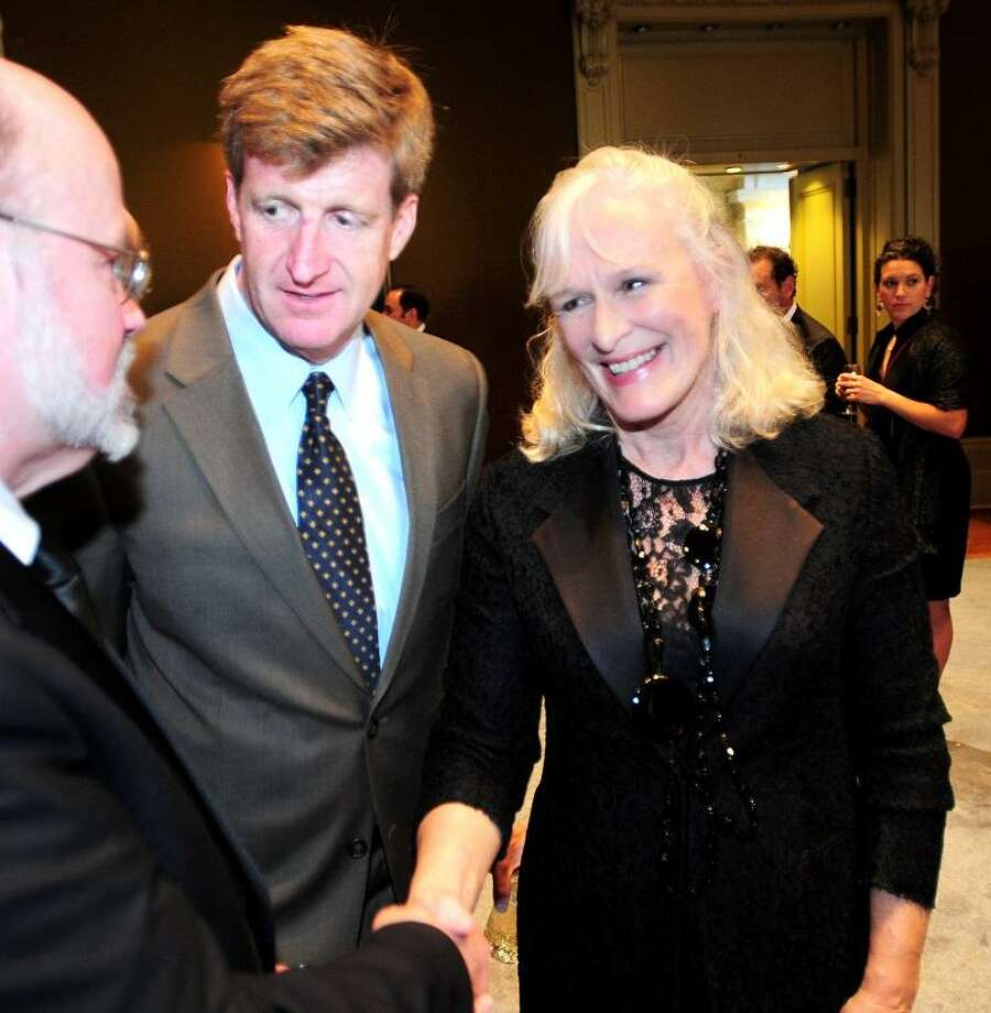 Wayne Lindstrom (left), President/CEO of Mental Health America, is introduced to actress Glenn Close (right) by former U.S. Rep. Patrick Kennedy (center) during a reception before the Clifford Beers Clinic Centennial Gala at Woolsey Hall in New Haven on 4/27/2013.Photo by Arnold Gold/New Haven Register  AG0494D