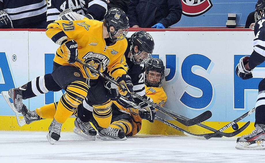 "Pittsburg, PA-- Yale Quinnipiac game action during the  NCAA Hockey National Championship.  Photo-Peter Casolino/Register <a href=""mailto:pcasolino@newhavenregister.com"">pcasolino@newhavenregister.com</a>"