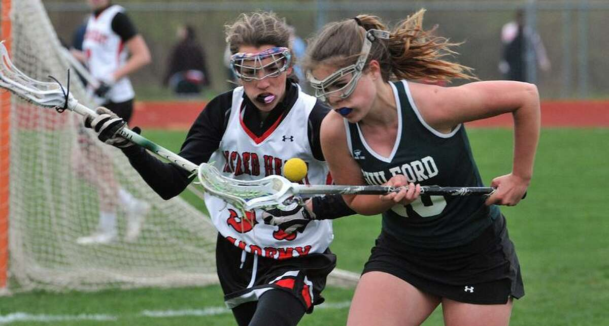 Hamden-- Sacred Heart Academy's _____ Campanelli and Guilford's Grace Ireland battle for a loose ball during the first half . Photo-Peter Casolino/Register pcasolino@newhavenregister.com