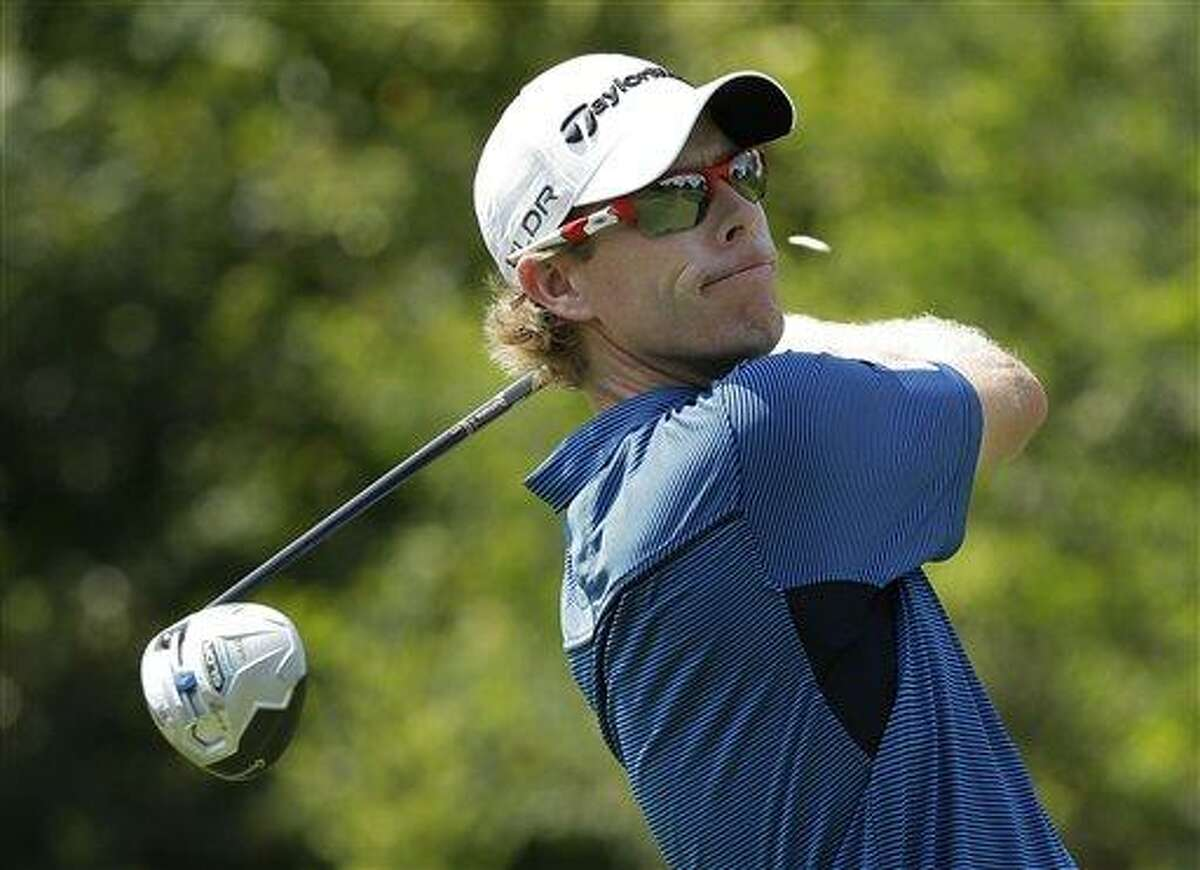 David Hearn, of Canada, watches his tee shot on the 17th hole during the first round of the PGA Championship golf tournament at Oak Hill Country Club, Thursday, Aug. 8, 2013, in Pittsford, N.Y. (AP Photo/Charlie Riedel)