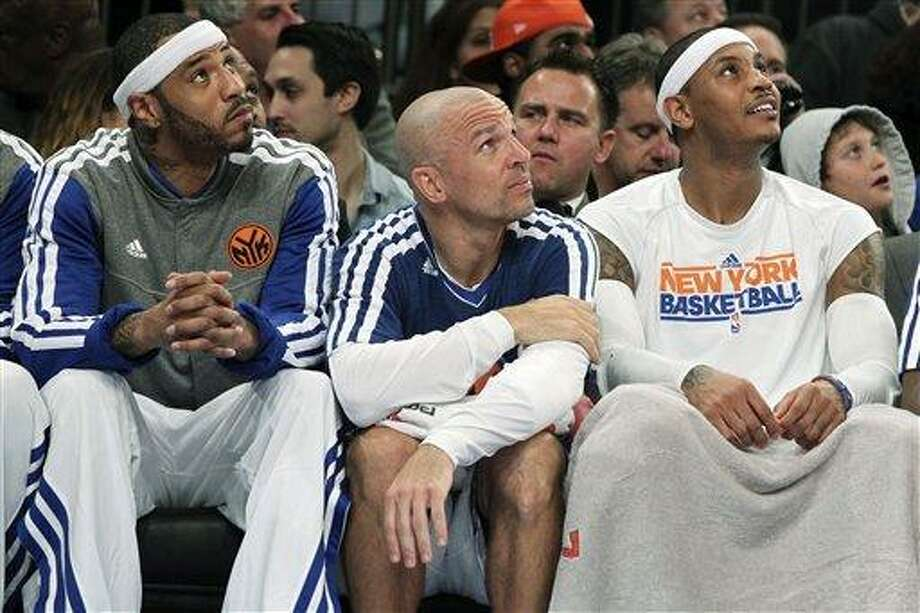 From left, New York Knicks' Kenyon Martin, Jason Kidd and Carmelo Anthony watch from the bench during the first half of an NBA basketball game against the Philadelphia 76ers, Sunday, Feb. 24, 2013, at Madison Square Garden in New York. (AP Photo/Mary Altaffer) Photo: ASSOCIATED PRESS / AP2013