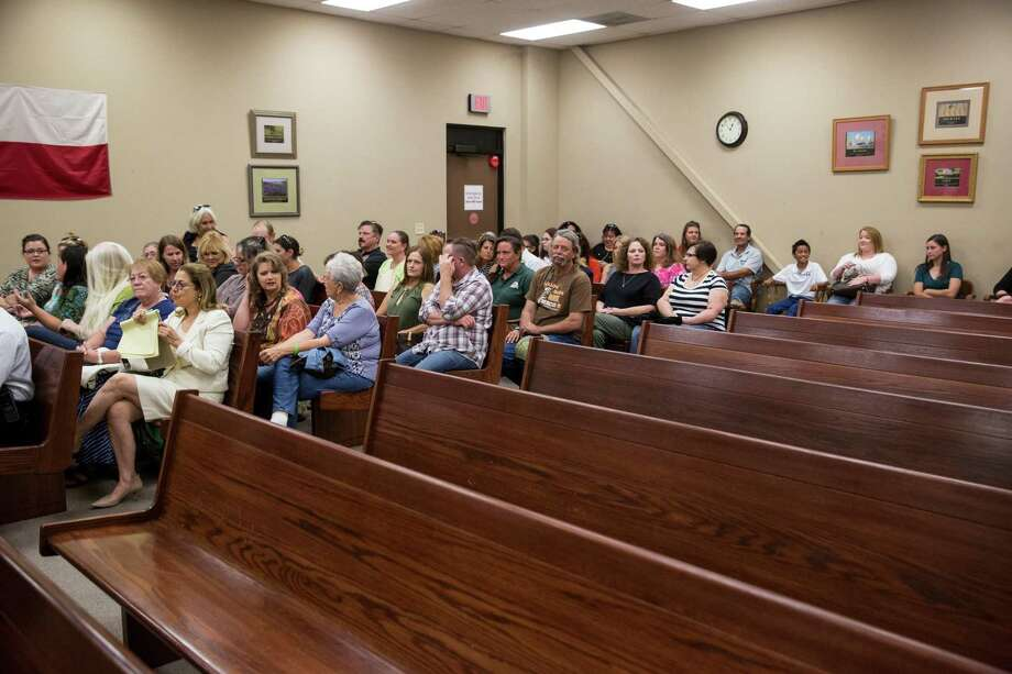 Supporters of Meadow Haven Horse Rescue sit on one side of the court room before a hearing at Bexar County Precinct 4 in San Antonio, Texas on July 25, 2017.  The hearing was about whether the custody of 46 horses removed because of neglect will go back to the owner Andrew Schwartz or to Meadow Haven Horse Rescue, where the horses are currently being kept. Photo: Carolyn Van Houten, Staff / San Antonio Express-News / 2017 San Antonio Express-News