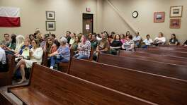 Supporters of Meadow Haven Horse Rescue sit on one side of the court room before a hearing at Bexar County Precinct 4 in San Antonio, Texas on July 25, 2017.  The hearing was about whether the custody of 46 horses removed because of neglect will go back to the owner Andrew Schwartz or to Meadow Haven Horse Rescue, where the horses are currently being kept.