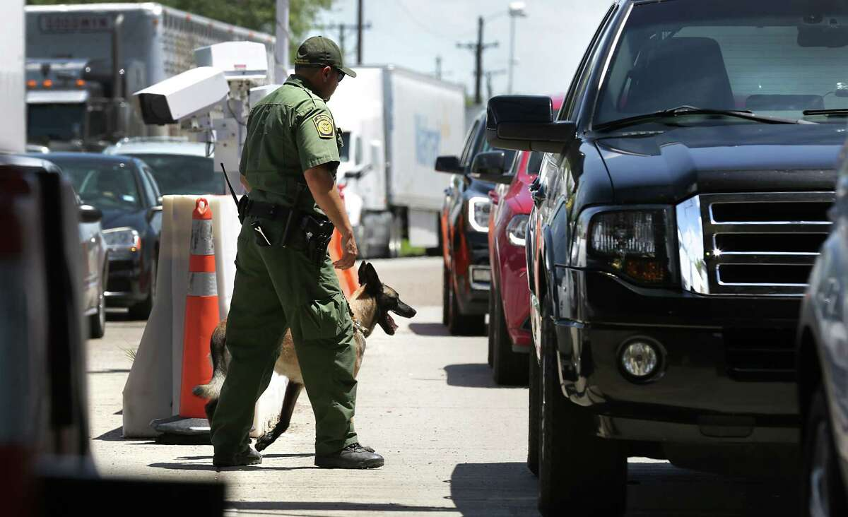 Border Patrol Agents inspect vehicles traveling north on U.S. 281 at the check point just south of Falfurrias, Texas, on Wednesday, July 19, 2017.