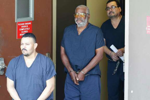 James Bradley, center, leaves the federal courthouse in San Antonio on Tuesday.
