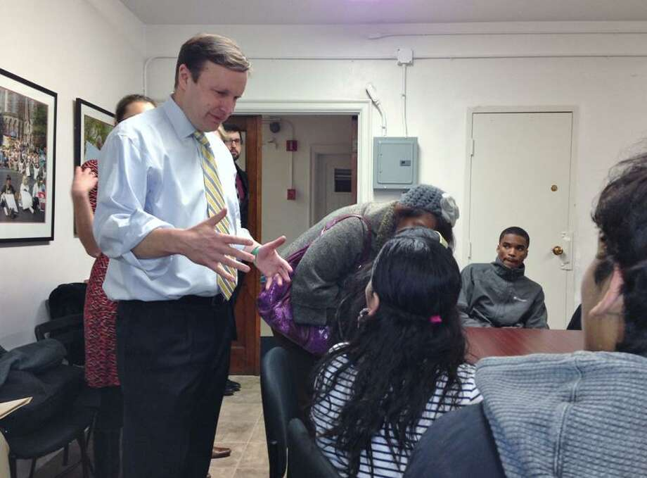 Murphy greets some of the students who filled a church basement conference room in New Haven. Photo by Joe Amarante