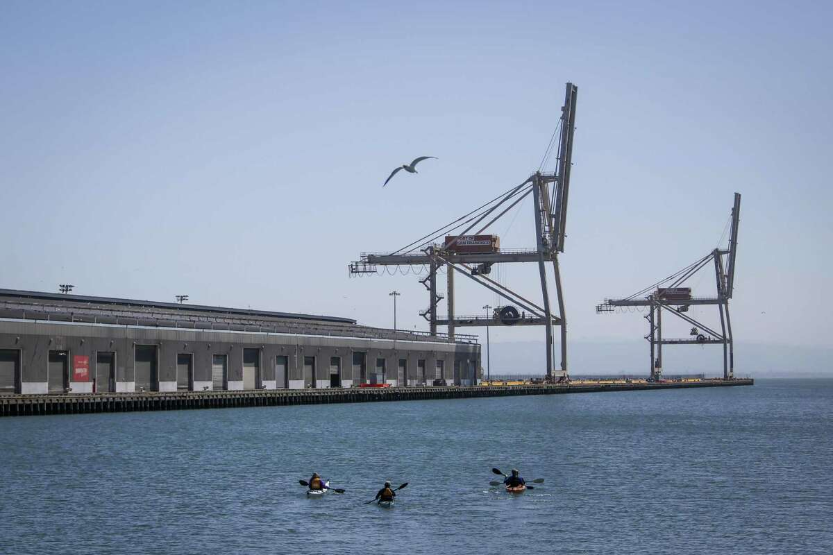 Kayakers paddle down the Islais Creek Channel in San Francisco on Thursday, July 19, 2017.