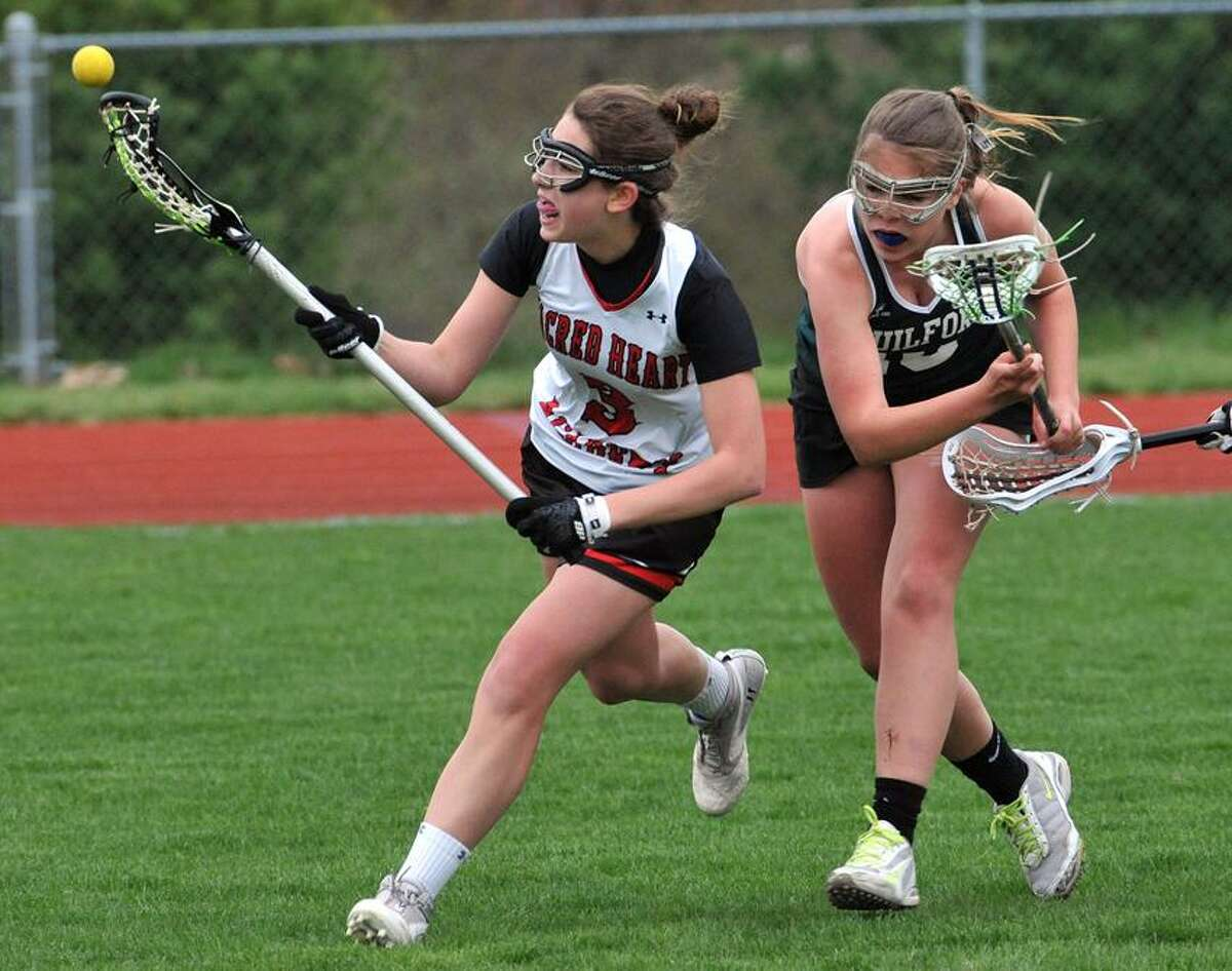 Guilford's Grace Ireland, right, defends during the first half of Tuesday's contest with Sacred Heart Academy. Photo-Peter Casolino/Register pcasolino@newhavenregister.com