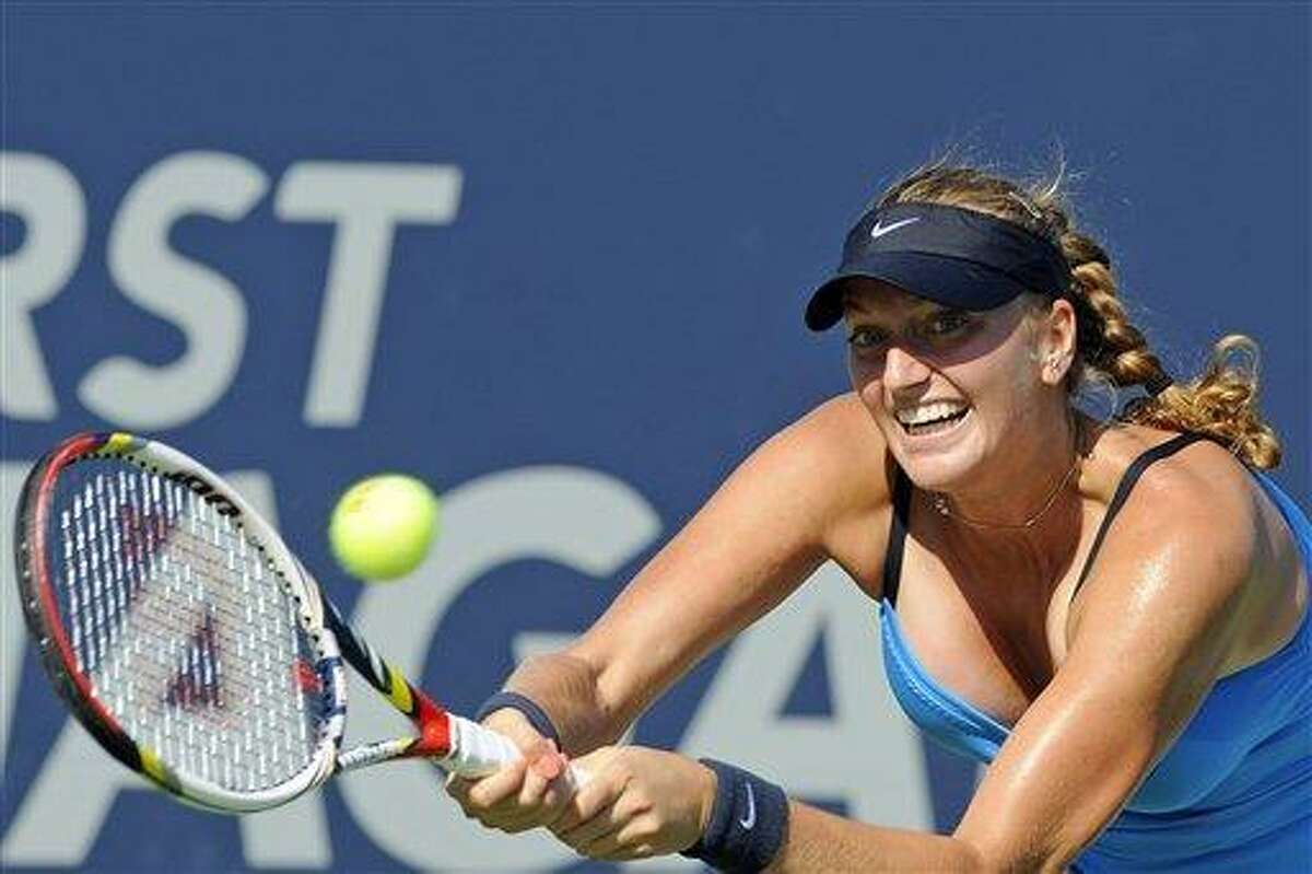 Petra Kvitova, of the Czech Republic, stretches for a backhand during her 7-6 (9), 7-5 victory over Maria Kirilenko, of Russia, in the final match of the New Haven Open tennis tournament in New Haven, Conn., on Saturday, Aug. 25, 2012. (AP Photo/Fred Beckham)