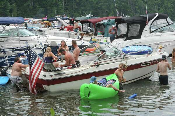 People enjoy the water during Log Bay Day, the annual party on the water on the east side of Lake George at Log Bay on Monday July 25, 2016 in Fort Ann, N.Y. (Lori Van Buren / Times Union)