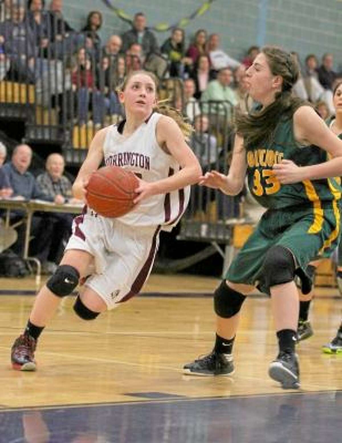 Torrington's Caroline Teti launches into a layup in her team's NVL semifinal victory against Holy Cross. Marianne Killackey/Special to Register Citizen