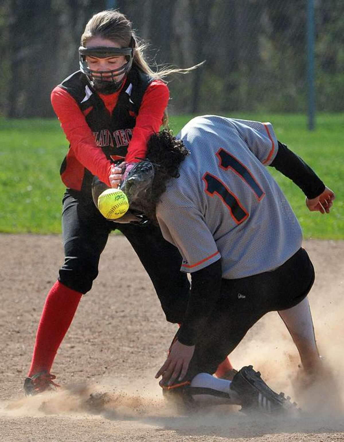 Milford-- Platt Tech's Amber Lewandowski tries to get the tag on Goodwin Tech's Jocelyn Burgos during a 4th inning stolen base. She was safe on the play. Photo-Peter Casolino/Register pcasolino@newhavenregister.com