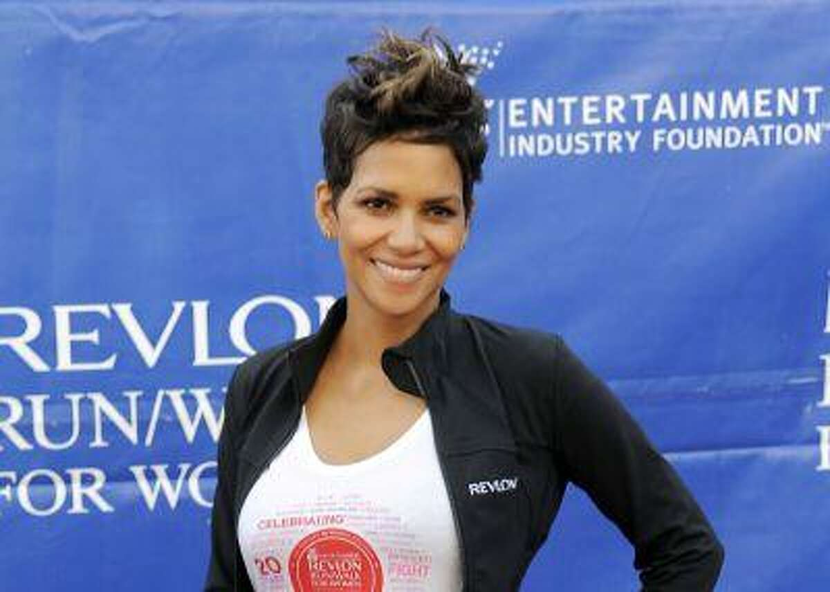 FILE - This May 11, 2013 file photo shows actress Halle Berry at the 20th Annual EIF Revlon Run/Walk For Women in Los Angeles. Berry is scheduled to testify on Tuesday in favor of California legislation that would limit the ability of paparazzi to photograph the children of celebrities. The hearing before the Assembly Committee on Public Safety is set for midmorning, although it's not clear exactly when Berry is expected to speak. (Photo by Chris Pizzello/Invision/AP, file)