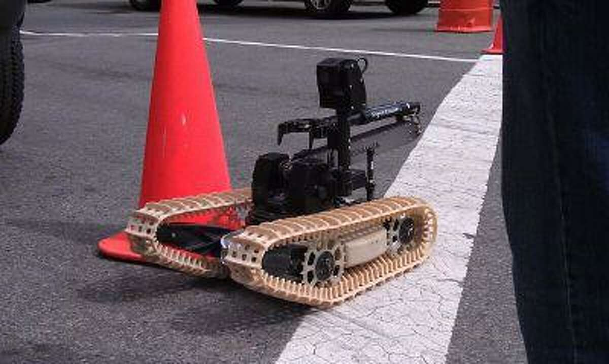 A bomb sweeper robot used by Boston police is deployed Saturday at the site of the Boston Marathon bombing in Copley Square.