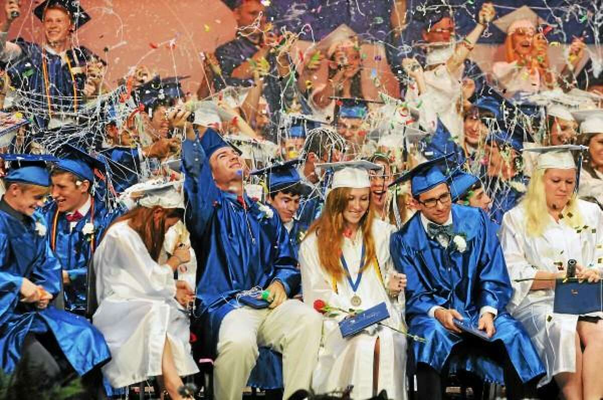 Catherine Avalone/The Middletown Press Coginchaug's class of 2013 celebrate with silly string and beach balls after receiving their diplomas at the Julian B. Thayer Auditorium Tuesday night at graduation.