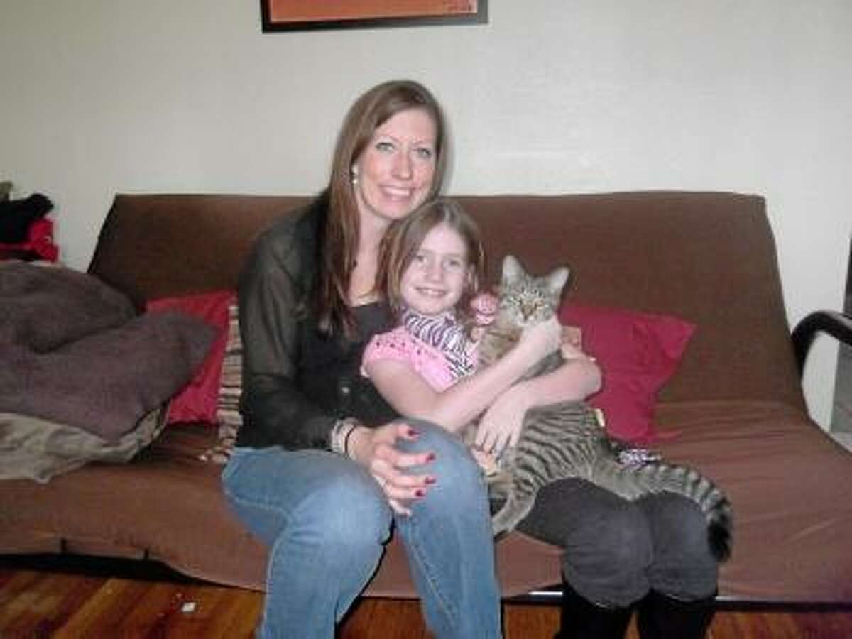 Mia Pickert, her mother Jacki Pickert and their cat Gizmo. Mia will be turning 9 on Feb. 23. Instead of asking for presents she requested people donate clothing items for people in need. NIKKI TRELEAVEN/The Register Citizen