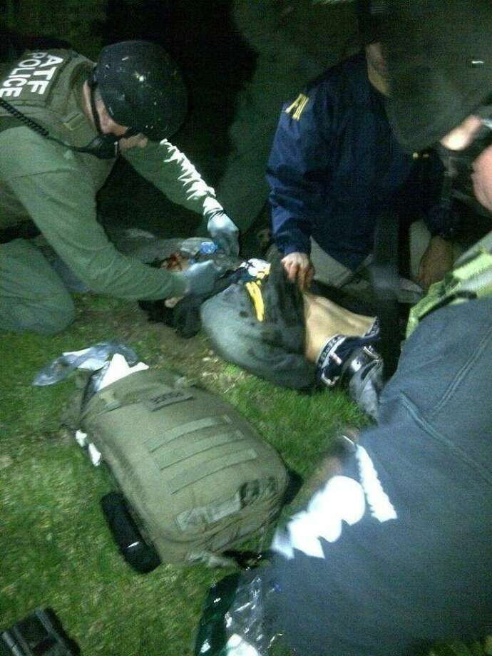 SWAT and FBI investigators give first aide to Boston Marathon bombing suspect moments after his arrest.