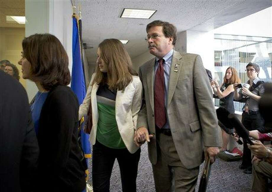 Bill Sherlach, with daughter Maura Lynn Schwartz, arrives with other families of the Newtown, Connecticut, school massacre to meet privately on Capitol Hill in Washington, Tuesday, April 9, 2013, with Sen. Richard Blumenthal, D-Conn., and Sen. Chris Murphy, D-Conn. His wife, Mary Sherlach, was a school psychologist who was killed during a mass shooting that left 26 people dead at Sandy Hook Elementary School in December 2012.   (AP Photo/J. Scott Applewhite) Photo: AP / AP