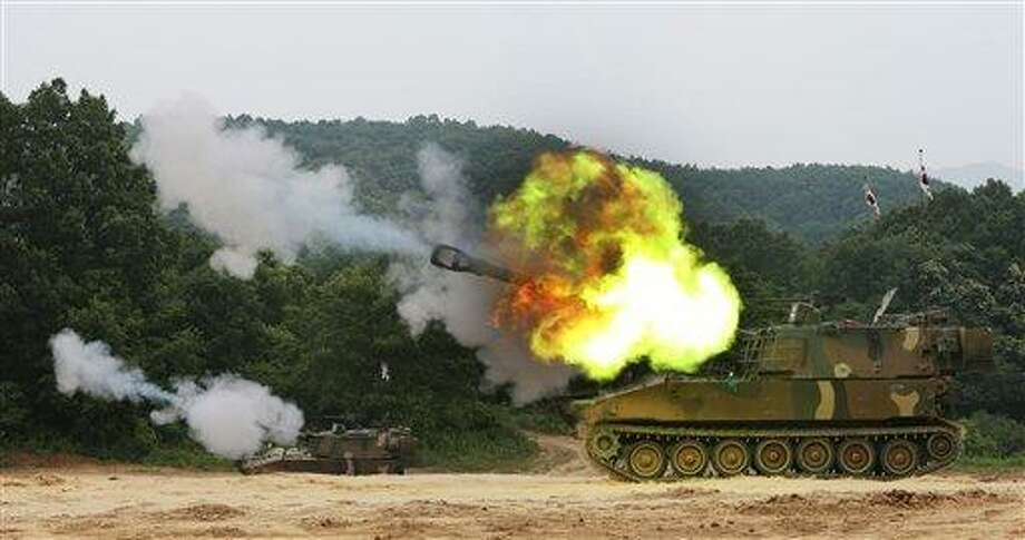 South Korean army's K-55 A1 self-propelled howitzers fire during a military exercise to mark the 63rd anniversary of the start of the Korean War in Yeoncheon near the demilitarized zone that divides the two Koreas, South Korea, Tuesday, June 25, 2013. The three-year Korean War broke out on June 25, 1950 when Soviet tank-led North Koreans invaded South Korea. (AP Photo/Yonhap, Lim Byung-shick) KOREA OUT Photo: AP / Yonhap
