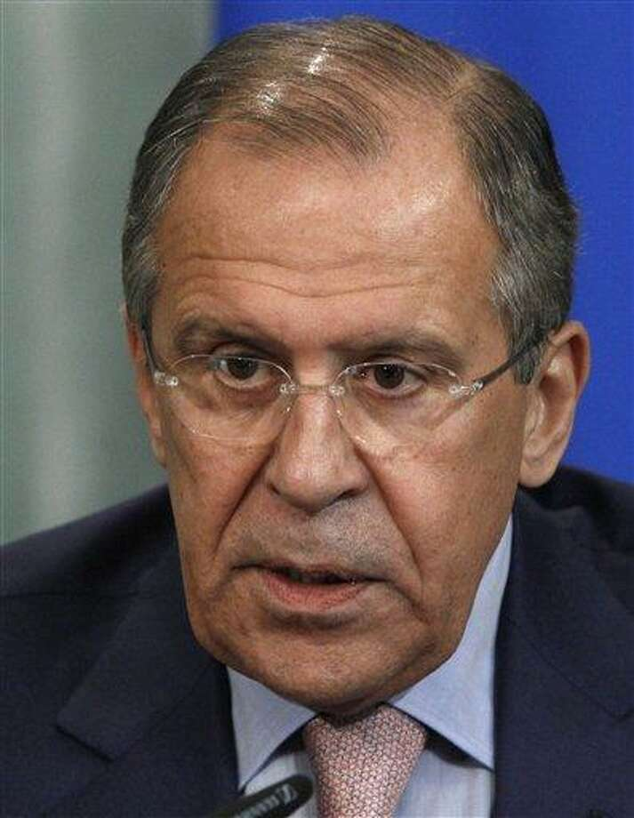 Russia's Foreign Minister Sergey Lavrov speaks at a news conference in Moscow on Tuesday, June 25, 2013. Lavrov on Tuesday bluntly rejected U.S. demands to extradite National Security Agency leaker Edward Snowden, saying that Snowden hasn't crossed the Russian border as he seeks to evade prosecution. Sergey Lavrov insisted that Russia has nothing to do with Snowden or his travel plans. Lavrov wouldn't say where Snowden is, but he angrily lashed out at the U.S. for demanding his extradition and warnings of negative consequences if Moscow fails to comply.  (AP Photo/Ivan Sekretarev) Photo: AP / AP
