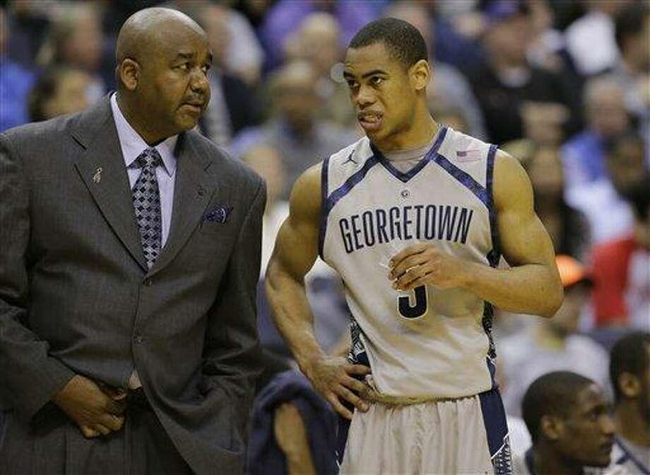 Georgetown head coach John Thompson III talks with guard Markel Starks. (AP Photo/Alex Brandon) Photo: AP / AP