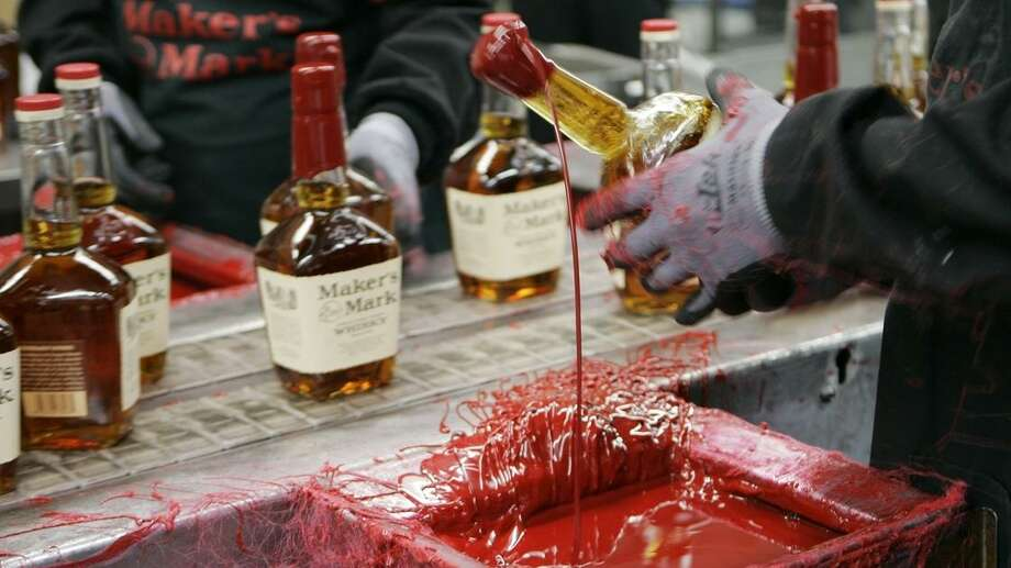 With too little distilled bourbon to meet demand, Maker's Mark is lowering the product's alcohol content from 90 to 84 proof. Photo: AP