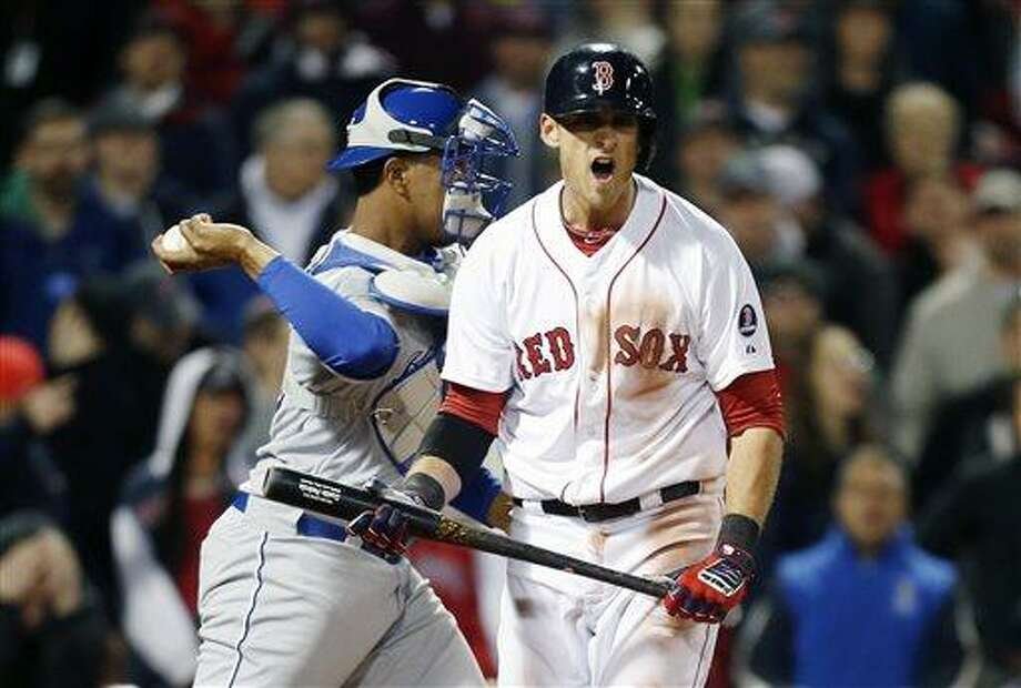Boston Red Sox's Will Middlebrooks, right, reacts in front of Kansas City Royals' Salvador Perez after striking out in the 10th inning of the second game of a baseball doubleheader in Boston, Sunday, April 21, 2013. The Royals won 5-4. (AP Photo/Michael Dwyer) Photo: AP / AP