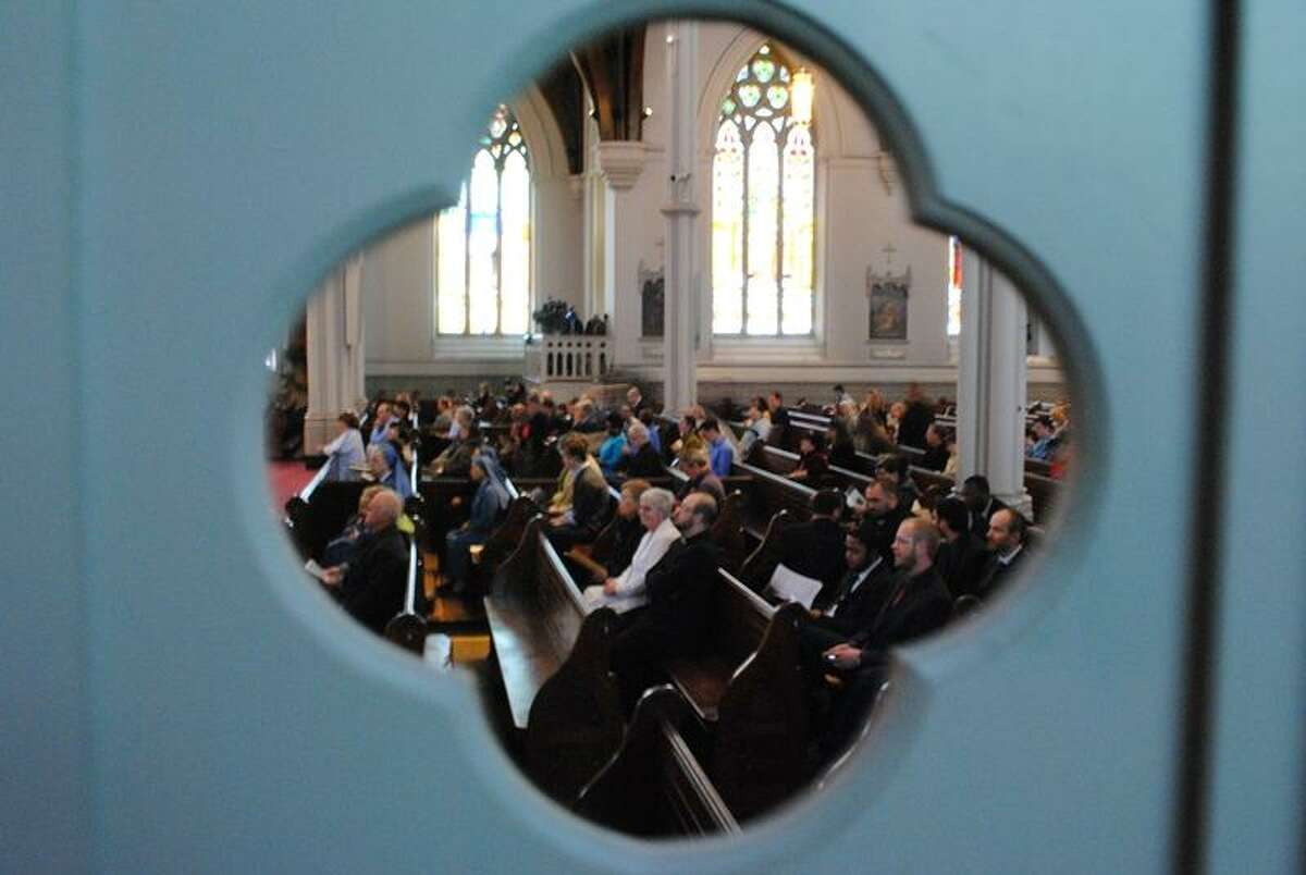 A view of worshipers inside Cathedral of the Holy Cross. Photo By Ashley May