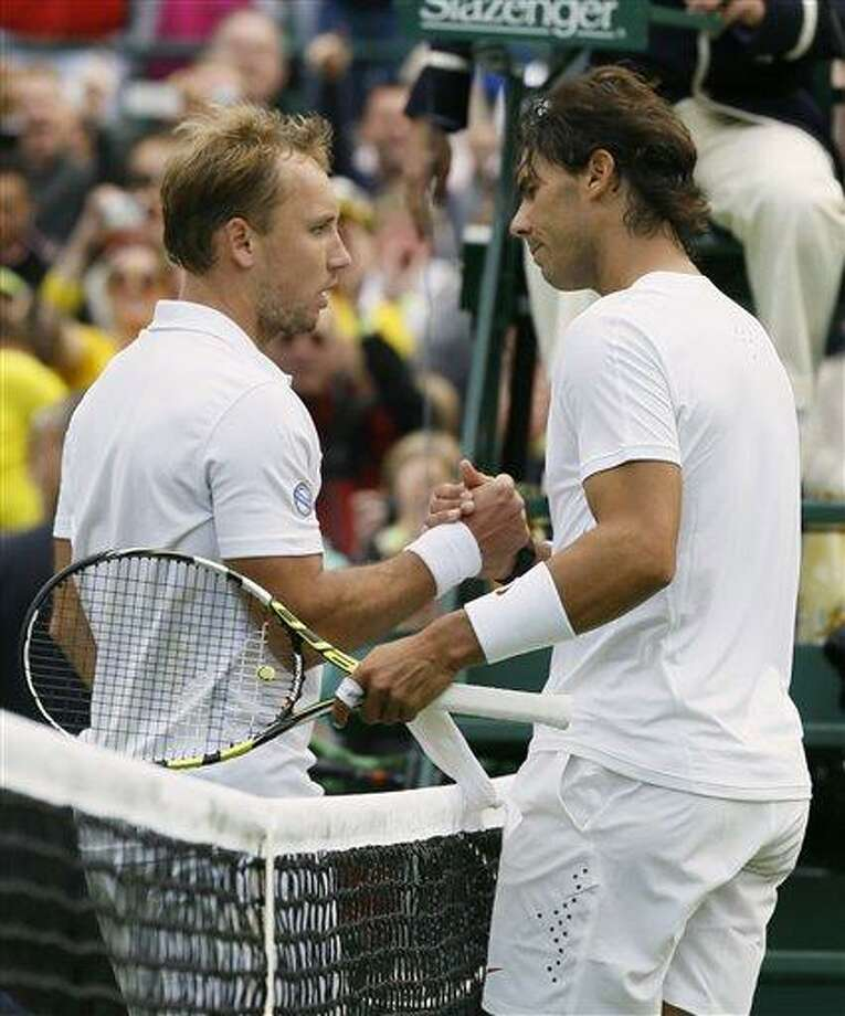 Rafael Nadal of Spain shakes hands with Steve Darcis of Belgium after he lost following their Men's first round singles match at the All England Lawn Tennis Championships in Wimbledon, London, Monday, June 24, 2013. (AP Photo/Kirsty Wigglesworth) Photo: AP / AP
