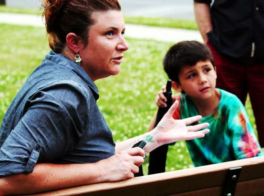 Left, Jessica Chiong with her son right, Hunter Chiong talk to a small group outside of West Haven City Hall about the protest against the Common Core Curriculum on 06/24/2013.  Nicole Dellolio/ For the Register