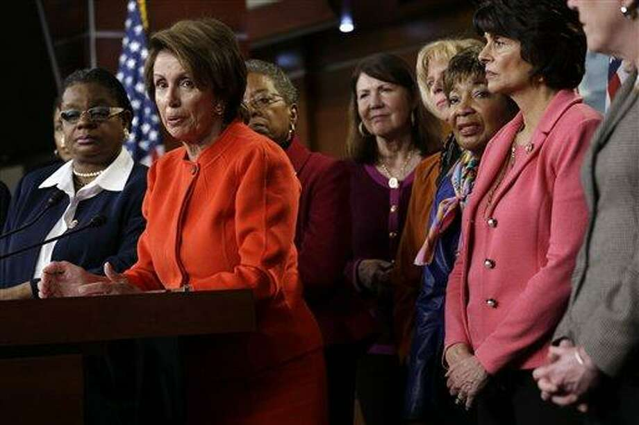 House Minority Leader Nancy Pelosi of Calif., center, accompanied by fellow House Democrats, leads a news conference on Capitol Hill in Washington, Wednesday, Jan. 23, 2013, to discuss the  reintroduction of the Violence Against Women Act. Congressional Democrats have renewed their push to revive the key federal program that protects women against domestic violence. They sought to diminish Republican objections that blocked passage of the legislation last year by removing a provision that would increase visas for immigrant victims of domestic abuse. Rep. Gwen Moore, D-Wis. is at left. (AP Photo/Jacquelyn Martin) Photo: ASSOCIATED PRESS / AP2013