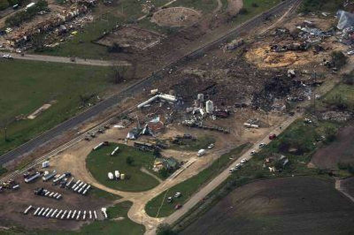 An aerial view shows the aftermath of a massive explosion at a fertilizer plant in the town of West, near Waco, Texas April 18, 2013. The death toll in explosion at the plant has reached 14 people, Mayor Tommy Muska said on Thursday. Among the 14 are four emergency medical technicians killed in the blast, which occurred on Wednesday evening after emergency responders rushed to put out a fire at the plant. REUTERS/Adrees Latif (UNITED STATES - Tags: DISASTER ENVIRONMENT AGRICULTURE)