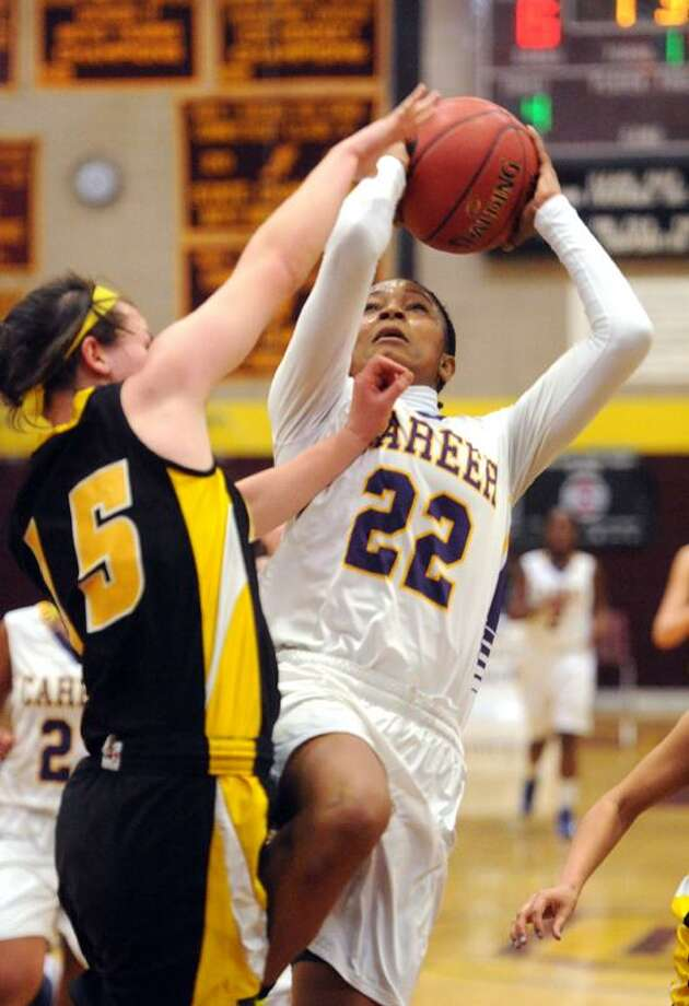 Career's Tanaya Atkinson scored 21 points before leaving with a possible head injury. Amity's Chloe Brinton at left. Mara Lavitt/New Haven Register