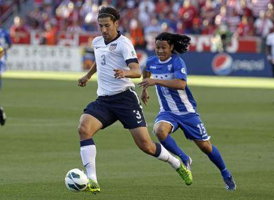 Honduras' Roger Espinoza (15) defends as United States' Omar Gonzalez (3) clears the ball in the first half during a World Cup qualifying soccer match at Rio Tinto Stadium on Tuesday, June 18, 2013, in Sandy, Utah. Photo: ASSOCIATED PRESS / AP2013