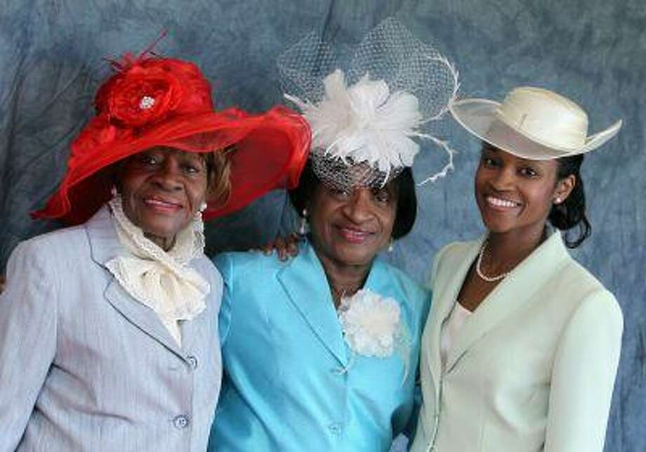 """EXHIBIT CLOTHES: Three generations of women from the Alfred Street Baptist Church in Alexandria, Va., show off their Sunday church hats. """"The Will to Adorn,"""" part of the Smithsonian Folklife Festival in Washington, is part of an eight-cities and the U.S. Virgin Islands-based collaborative research project that began in 2010 to examine African American dress and identity. Illustrates EXHIBIT-CLOTHES (category l) by Lonnae O'Neal Parker &Copy; 2013, The Washington Post. Moved Friday, June 21, 2013. (MUST CREDIT: Sharon Farmer/ National Museum of African American History & Culture).)"""