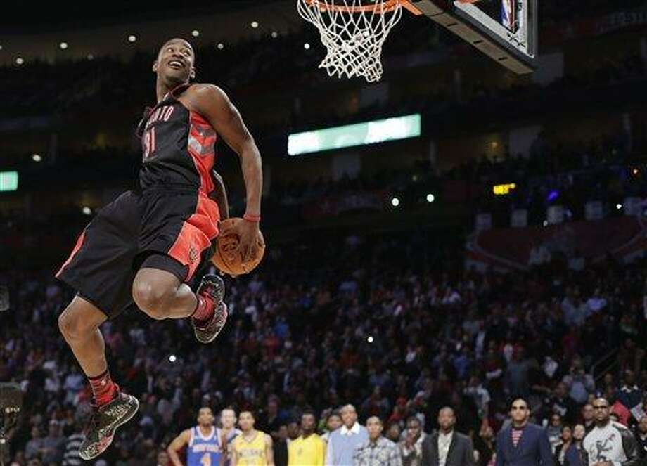 Terrence Ross of the Toronto Raptors goes up during the dunk contest at NBA basketball All-Star Saturday Night, Feb. 16, 2013, in Houston. (AP Photo/Eric Gay) Photo: ASSOCIATED PRESS / AP2013