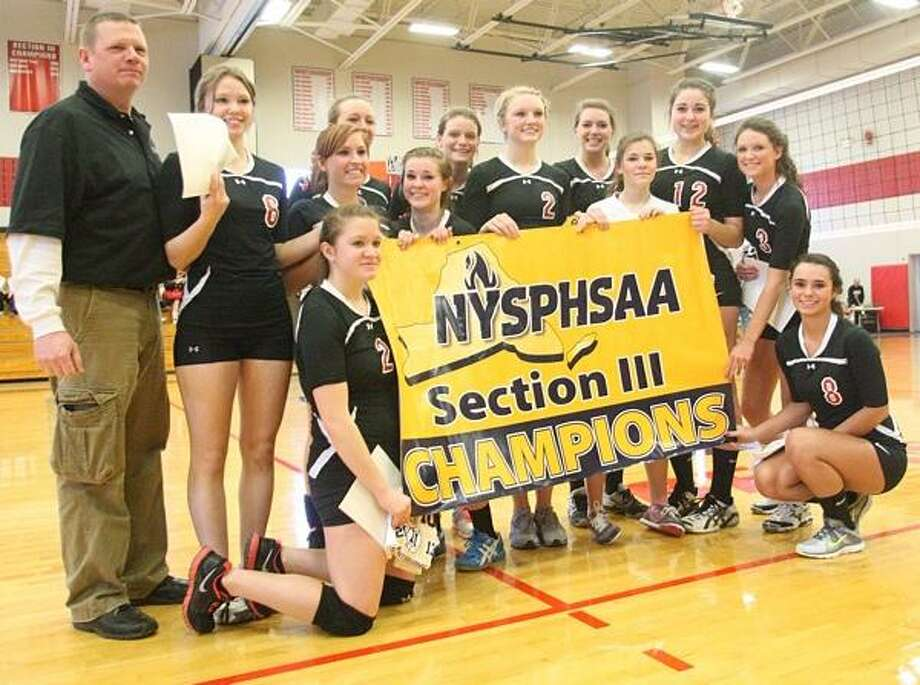 "Dispatch Staff Photo by JOHN HAEGER <a href=""http://twitter.com/oneidaphoto"">twitter.com/oneidaphoto</a> M-E players pose with their banner after sweeping Dolgeville to win the Class C-2 girls volleyball title on Saturday, Feb. 16, 2013 in Chittenango."