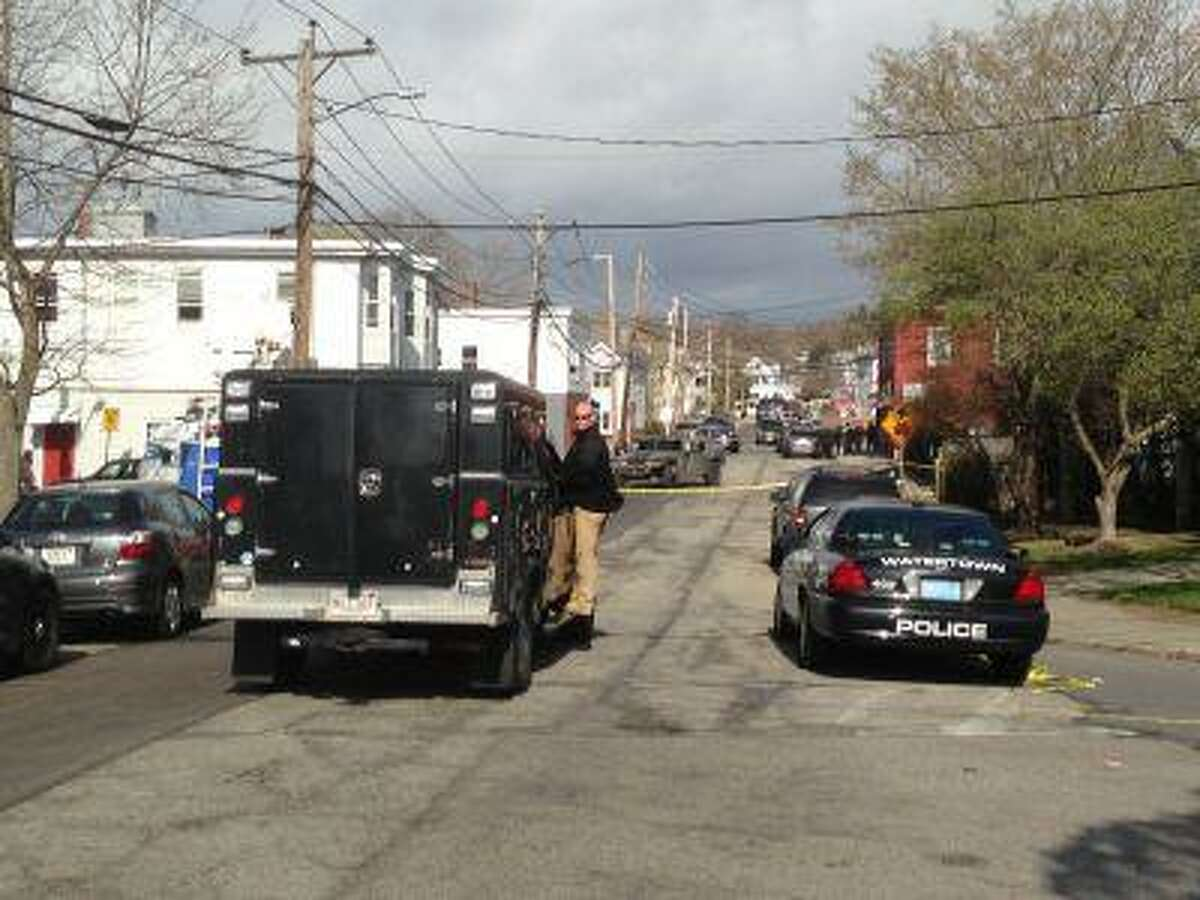 The police presence Friday morning in Watertown, Mass., was highly visible as authorities sought a second suspect in the Boston Marathon bombings after the first was killed in a confrontation early Friday morning.