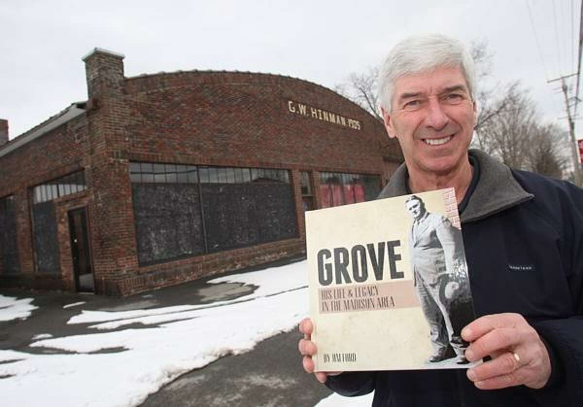 """Dispatch Staff Photo by JOHN HAEGER twitter.com/oneidaphoto Author Jim Ford holds his latest book """" Grove His Life and Legacy in the Madison Area"""" as his poses in front of the G.W. Hinman building on Friday, Feb. 15, 2013 in Madison."""