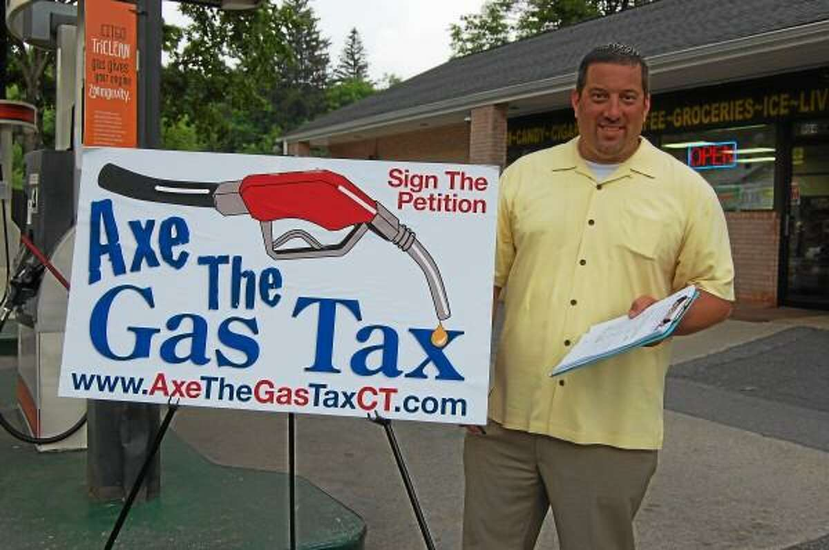 State Rep. Jay Case petitions against a gas tax hike in Winsted on June 24. (Mercy Quaye-Register Citizen)