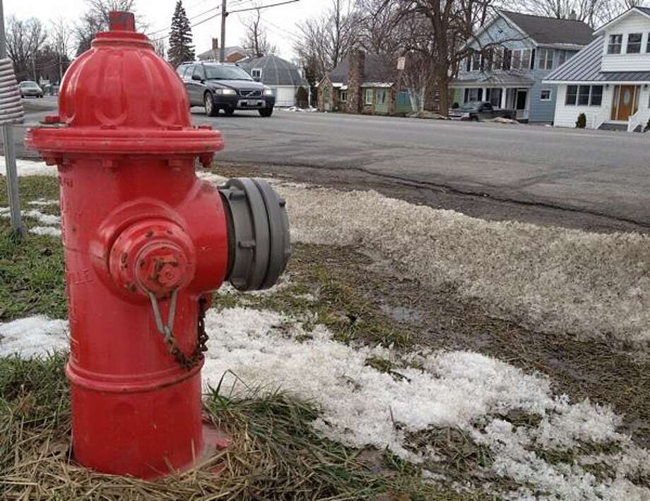 "Dispatch Staff Photo by JOHN HAEGER <a href=""http://twitter.com/oneidaphoto"">twitter.com/oneidaphoto</a> A fire hydrant near the corner of West Seneca Street and School Street in the village of Vernon on Friday, Feb. 15, 2013 Photo: Oneida Daily Dispatch / Oneida Daily Dispatch"